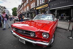 © Licensed to London News Pictures. 17/06/2018. LONDON, UK. A 1965 GT Mustang Optioned Convertible at the 6th Annual Classic and Supercar Pageant held at St John's Wood High Street.  Traditionally taking place on Fathers' Day, the show brings together an eclectic mix of exotic and popular vehicles attracting visitors young and old and raises funds for the local charity, The St John's Hospice.  Photo credit: Stephen Chung/LNP