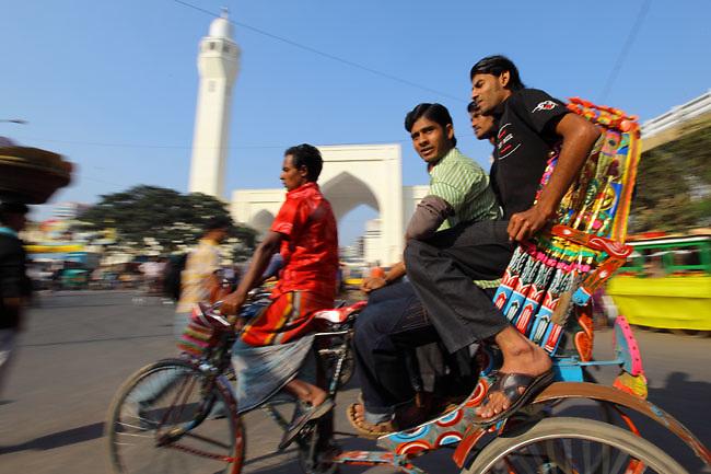 Rickshaw in the crowded traffic of Old Dhaka (Dhaka, Bangladesh).
