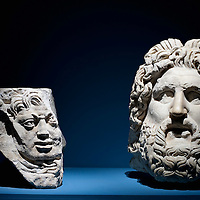 """MILAN, ITALY - JUNE 01:  An architectural element with head of Medusa in stone and a  head of Juppiter in marble, at """"I due Imperi"""" exhibition on June 1, 2010 in Milan, Italy. The Exhibition illustrates the birth and development of the Roman Empire and the Empire of the Chinese Qin and Han Dinasties  (Photo by Marco Secchi/Getty Images)"""