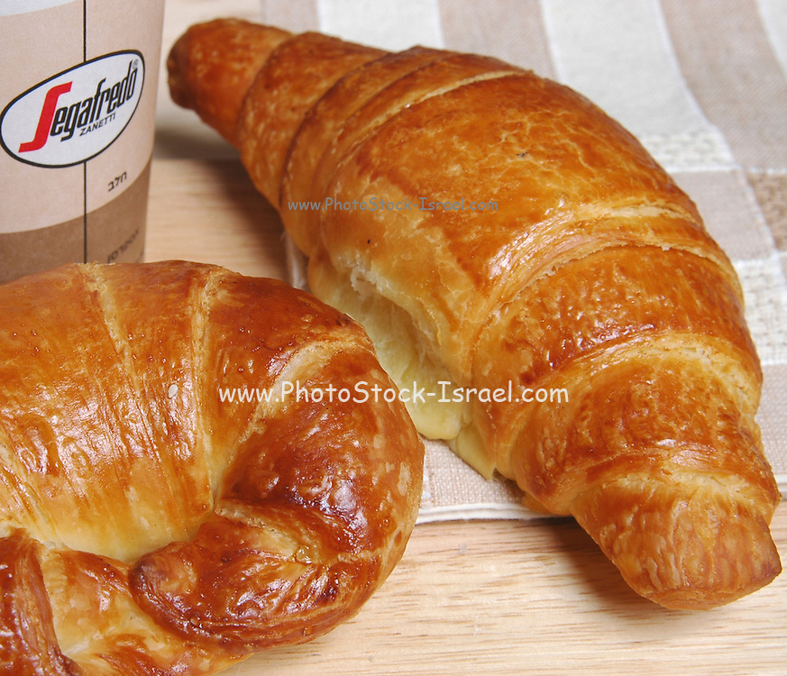 Two croissants and a cup of coffee to go