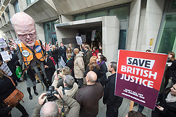 Hundreds of Lawyers,Solicitors and legal workers whilst bringing the legal system to a halt outside the Justice Department to protest against legal aid cuts. London, United Kingdom. Friday, 7th March 2014. Picture by  i-Images / i-Images
