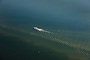 Nederland, Flevoland, Ketelmeer, 01-05-2013; jacht vaart in met bakens aangegeven vaargeul voor de kust van Flevoland en maakt met kielzog een hekgolf.<br /> <br /> luchtfoto (toeslag op standard tarieven)<br /> aerial photo (additional fee required)<br /> copyright foto/photo Siebe Swart