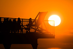 © Licensed to London News Pictures. 07/07/2018. Aberystwyth, UK. Sunset over Aberystwyth pier at the end of another scintillatingly hot day, as the UK wide heat wave and very dry weather continues unbroken. Photo credit: Keith Morris/LNP