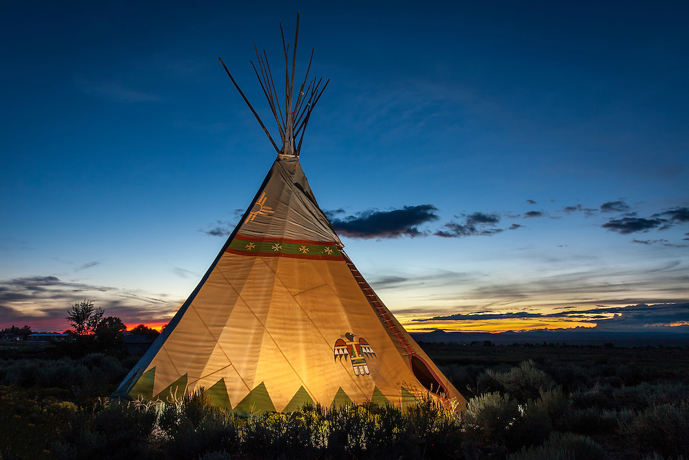 The colors of twilight provide the backdrop for this  beautiful teepee near Taos, New Mexico