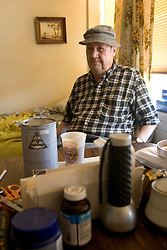 03 Sept  2005. New Orleans, Louisiana. Post hurricane Katrina.<br /> Shocked residents of the St Christopher's Inn retirement home were abandoned by their carers on the eve of the storm and left to fend for themselves. Running low on water, food and cigarettes, Tommy 'The Hat' Lennon (76yrs) tried his best to remain calm before residents were rescued six days later by New Orleans 8th district police.<br /> Photo Credit ©: Charlie Varley/varleypix.com