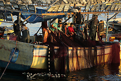 November 8, 2016 - Gaza, gaza strip, Palestine - Palestinian fishermen clean a net after a night fishing trip, in the Gaza seaport,  Nov. 8, 2016. (Credit Image: © Majdi Fathi/NurPhoto via ZUMA Press)