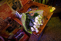 bouquet of white roses at a Paris bar - photograph by Owen Franken