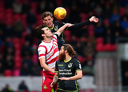Joe Partington of Bristol Rovers challenges John Marquis of Doncaster Rovers - Mandatory by-line: Robbie Stephenson/JMP - 27/01/2018 - FOOTBALL - The Keepmoat Stadium - Doncaster, England - Doncaster Rovers v Bristol Rovers - Sky Bet League One