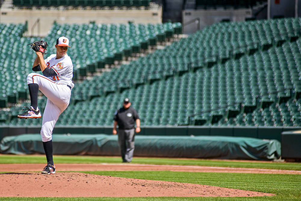 Baltimore, MD - April 29, 2015: Baltimore Orioles starting pitcher Ubaldo Jimenez pitches to an empty stadium at Oriole Park at Camden Yards on April 29, 2015. The civil unrest in Baltimore has forced the game between the Chicago White Sox and Baltimore Orioles to be closed to the public and moved to the afternoon. (Matt Roth for ESPN)