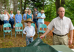 Logan Winny, 7, of Lebanon, left, takes his position in the front row as Mike Schwarz, facilities manager of Lyme Properties, right, waits for the right moment to unveil a scale model of the company's proposed development in West Lebanon Sunday, July 19, 2009. West Lebanon residents were shown the model during a picnic on the proposed 38 acre site between Route 10 and the Connecticut River.<br /> Valley News - James M. Patterson<br /> jpatterson@vnews.com<br /> photo@vnews.com