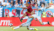 Salomon Rondon of Venezuela strikes on goal as Argentinian defenders Javier Masherano, left, and Nicolas Otamendi go for the challenge during a quarter-final matchup of the Copa America Centenario 2016 in Foxborough, Massachusetts, Saturday June 18, 2016.