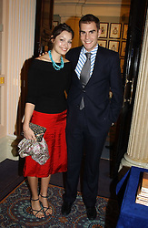 OSCAR HUMPHRIES and SARA PHILIPPIDIS at a party to celebrate the publication of 'Reflections in Middle Years' by Michael Wynne Parker was held at the Royal Airforce Club, 128 Piccadilly, London on 12th May 2005.<br />