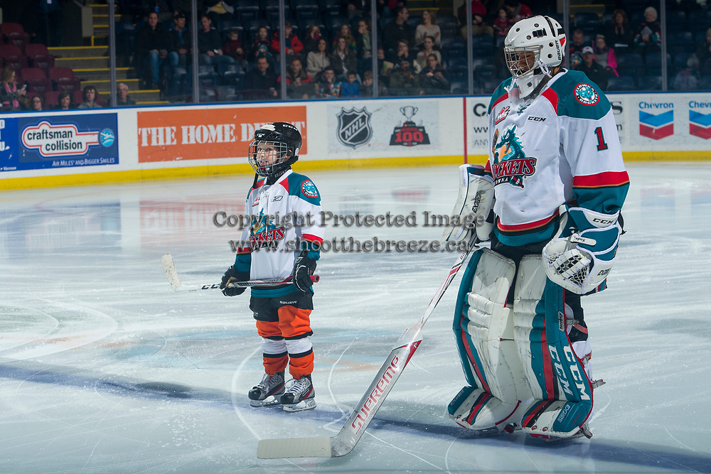 KELOWNA, CANADA - JANUARY 5: The pepsi save on foods player of the game lines up on the blue line alongside James Porter #1 of the Kelowna Rockets on January 5, 2017 at Prospera Place in Kelowna, British Columbia, Canada.  (Photo by Marissa Baecker/Shoot the Breeze)  *** Local Caption ***