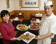 Lisa Chen and Ben Chen hold dishes with some of the vegetarian dishes available True  City restaurant in Pine Bush on Nov. 1, 2007.