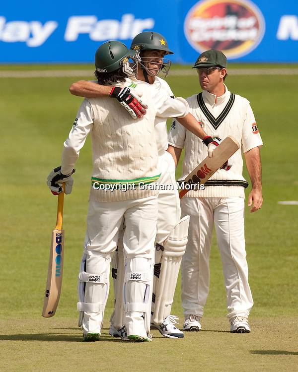 Losing captain Ricky Ponting watches as Umar Gul and Mohammad Amir (left) celebrate winning the second MCC Spirit of Cricket Test Match between Pakistan and Australia at Headingley, Leeds.  Photo: Graham Morris (Tel: +44(0)20 8969 4192 Email: sales@cricketpix.com) 24/07/10