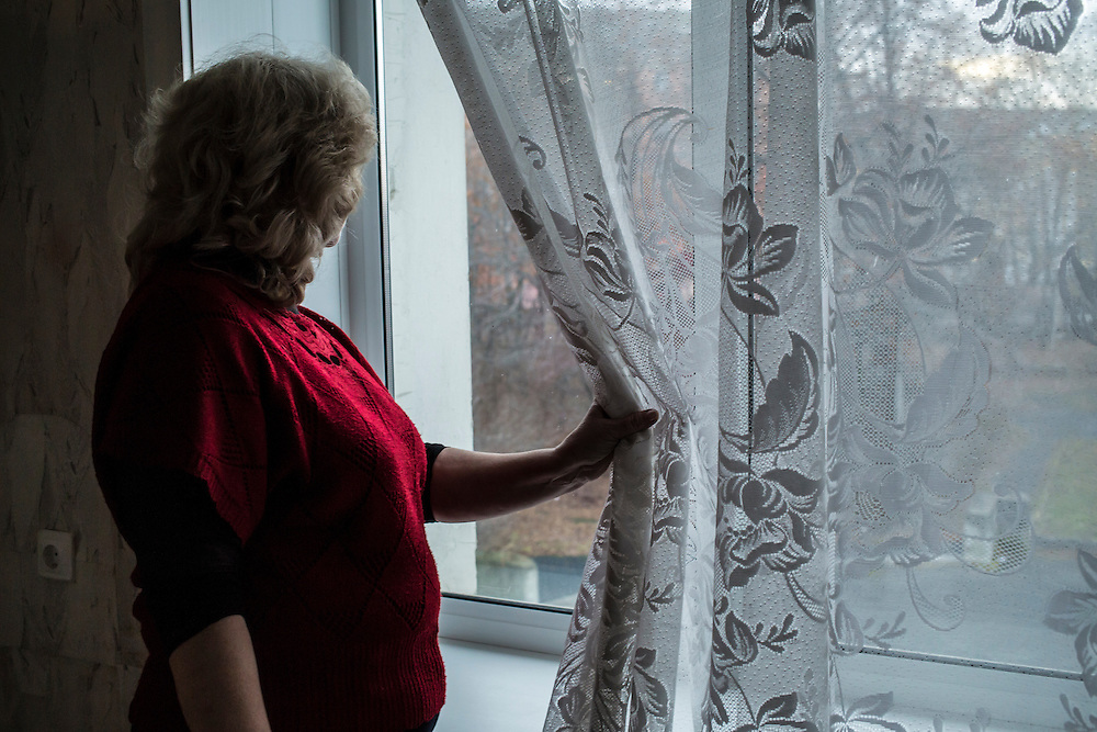 Ekaterina Khalitova, director of Asbest's arts center, looks out a window of the building on Monday, November 11, 2013 in Asbest, Russia.