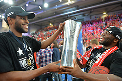 21.06.2015, Brose Arena, Bamberg, GER, Beko Basketball BL, Brose Baskets Bamberg vs FC Bayern Muenchen, Playoffs, Finale, 5. Spiel, im Bild Die Spieler der Brose Baskets Bamberg bejubeln den Gewinn der Deutschen Meisterschaft 2015. Im Bild: Darius Miller (Brose Baskets Bamberg / links) und Dawan Robinson (Brose Baskets Bamberg / rechts) mit Meister-Pokal. // during the Beko Basketball Bundes league Playoffs, final round, 5th match between Brose Baskets Bamberg and FC Bayern Muenchen at the Brose Arena in Bamberg, Germany on 2015/06/21. EXPA Pictures © 2015, PhotoCredit: EXPA/ Eibner-Pressefoto/ Merz<br /> <br /> *****ATTENTION - OUT of GER*****
