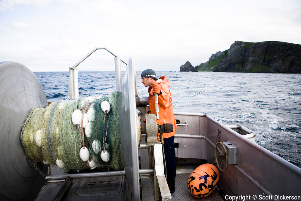 Keith Bell sets out the gillnet while commercial sockeye salmon fishing in the Eastern Aleutian Islands, area M, region aboard the F/V Lucky Dove. Motion blur