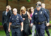 Aurora, Colorado police and others arrive for a memorial service for Gordon Cowdon at Pathways church in Denver July 25, 2012.  Cowden along with 11 others was killed in a shooting at a movie theater in Aurora, Colorado July 20, 2012.  REUTERS/Rick Wilking (UNITED STATES)