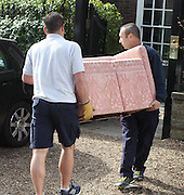 14.MARCH.2012. LONDON<br /> <br /> REMOVAL MEN UNLOADING THE FURNITURE OF KATE MOSS AND JAMIE HINCE AS THE COUPLE PREPARE TO MOVE INTO THEIR NEW HOME IN HIGHGATE, LONDON<br /> <br /> BYLINE: EDBIMAGEARCHIVE.COM<br /> <br /> *THIS IMAGE IS STRICTLY FOR UK NEWSPAPERS AND MAGAZINES ONLY*<br /> *FOR WORLD WIDE SALES AND WEB USE PLEASE CONTACT EDBIMAGEARCHIVE - 0208 954 5968*