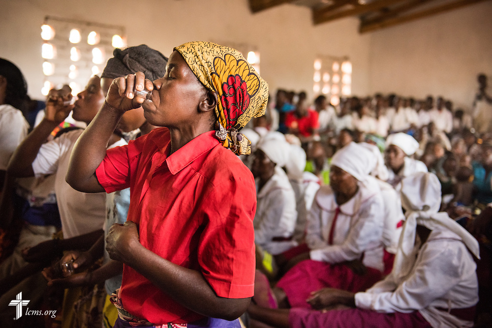Parishioners participate in the Lord's Supper during communion at a Confessional Lutheran Church–Malawi Synod parish worship service on Sunday, Sept. 27, 2015, in Chingale, Malawi. LCMS Communications/Erik M. Lunsford