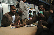 """Roma, 23 febbraio 2004: """"Hotel Africa"""", in un capannone delle Ferrovie dello Stato nei pressi della stazione Tiburtina vivono 300 rifugiati eritrei e sudanesi in attesa di essere convocati dalla commissione che valuta le domande di asilo - """"Hotel Africa"""", in a shed near the State Railways of Tiburtina station live 300 Sudanese and Eritrean refugees waiting to be summoned by the committee that evaluates applications for asylum seekers. ©Andrea Sabbadini"""