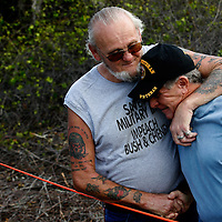 "PORT CHARLOTTE, FL -- March 12, 2008 -- Vietnam veterans Charlie Shaughnessy, right, and Thomas ""Wolf"" McCarthy embrace as they return to the site where Charlie found the body of former Marine Eric Hall in Port Charlotte, Fla., on Wednesday, March 12, 2008.  Hall went missing on Feb. 3 after having a flashback to his time in Iraq, and was found dead weeks later by Vietnam veteran volunteers in a culvert.  Shaughnessy found the body after crawling 50 yards into the drainage pipe after sensing an odor coming from it - an effort he says was eerily similar to his experiences in the Vietnam War."