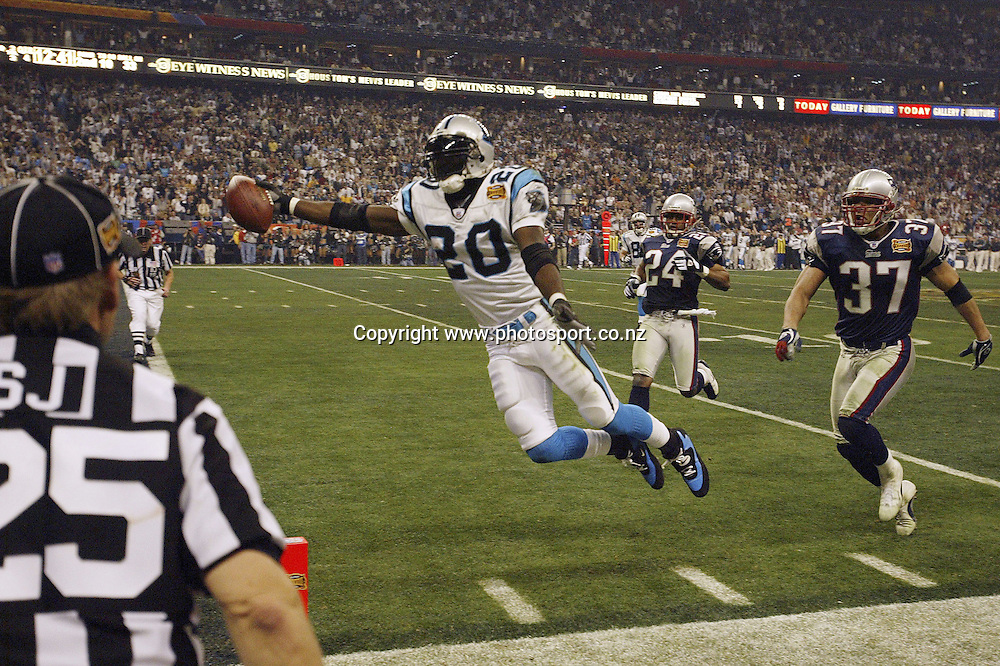 1 Feb 2004:    DeShaun Foster of the Carolina Panthers leaps into the endzone for a touchdown during the Panthers 32-29 loss to the New England Patriots in Super Bowl XXXVIII at Reliant Stadium in Houston, TX.<br /> Mandatory Credit:  Dilip Vishwanat/Sporting News/Icon SMI