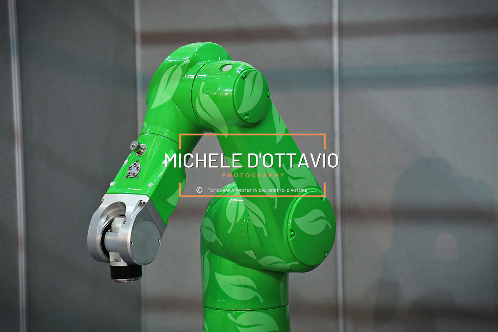 Green robotic arm with skin texture