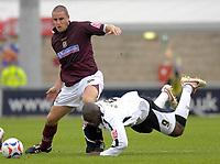 Photo: Daniel Hambury.<br />Northampton Town v Swansea City. Coca Cola League 1. 28/10/2006.<br />Northampton's Chris Doig and Swansea's Adebayo Akinfenwa battle.