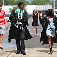 Mooreville High School seniors Santo Jamerson and Shayla Hadley through the parking lot to gather with their classmates before the start of Mooreville's graduation ceremony Saturday afternoon at the BancorpSouth Arena.