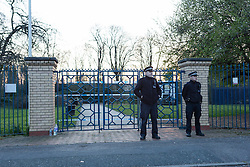 © Licensed to London News Pictures. 25/03/2016. London, UK. Police officers outside the police cordon at the Forest Lane Park entrance in Magpie Close in Forest Gate, east London. Five people have been taken to hospital, with one man in a critical condition. Photo credit : Vickie Flores/LNP