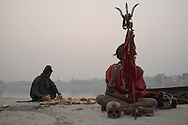 Baba G (R) is waiting for Rahm (L) to finish preparations to perform the Sasan Kali Spiritual Ritual. Varanasi, India.