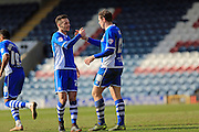 Grant Holt congratulated by Michael Rose 1-1 during the Sky Bet League 1 match between Rochdale and Southend United at Spotland, Rochdale, England on 25 March 2016. Photo by Daniel Youngs.