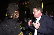 Darrin de-Grads and suggs. Smile1-D in association with Emporio Armani.  Wapping Power Station. 3 April 2001. © Copyright Photograph by Dafydd Jones 66 Stockwell Park Rd. London SW9 0DA Tel 020 7733 0108 www.dafjones.com