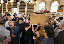 © Licensed to London News Pictures. 14/07/2017. London, UK. Family members and mourners carry the coffin of Mr Ali Jafari from the Hussaini Islamic Mission following funeral prayers. Mr Jafari, 82, was killed in the fire that destroyed Grenfell Tower in June. Photo credit: Peter Macdiarmid/LNP