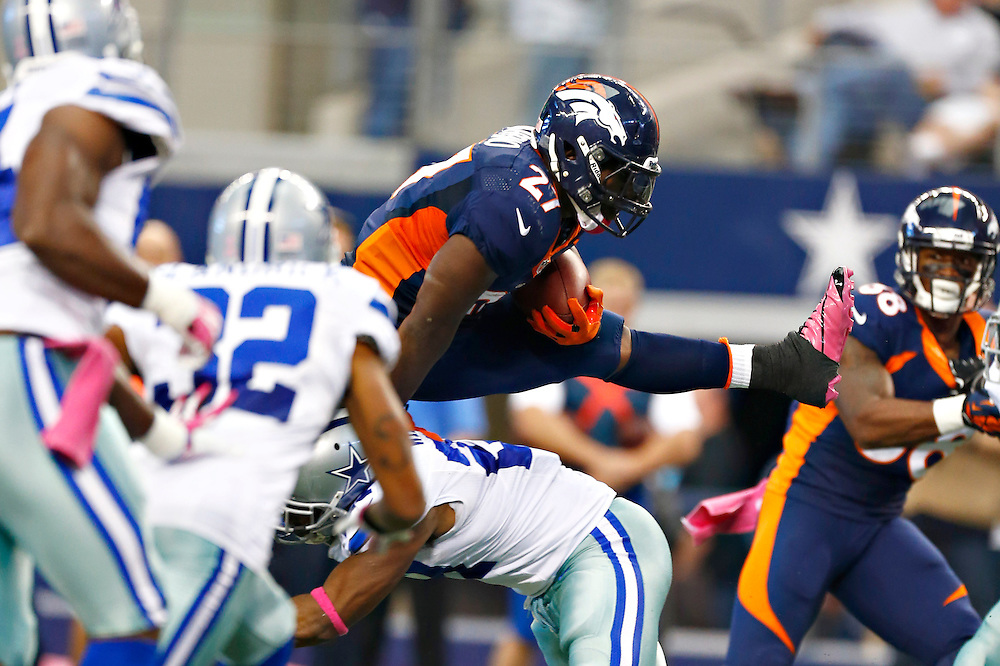 ARLINGTON, TX - OCTOBER 6:  Knowshon Moreno #27 of the Denver Broncos hurdles a defender during a game against the Dallas Cowboys at  AT&T Stadium on October 6, 2013 in Arlington, Texas.  (Photo by Wesley Hitt/Getty Images) *** Local Caption *** Knowshon Moreno