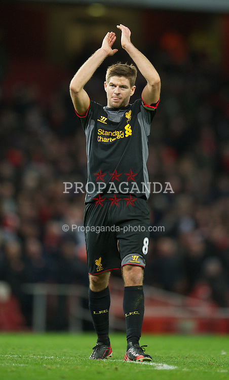 LONDON, ENGLAND - Wednesday, January 30, 2013: Liverpool's captain Steven Gerrard applauds the travelling supporters after the 2-2 draw with Arsenal during the Premiership match at the Emirates Stadium. (Pic by David Rawcliffe/Propaganda)
