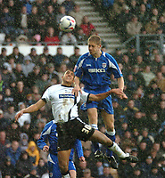 Photo: Ian Hebden.<br />Derby County v Millwall. Coca Cola Championship. 08/04/2006.<br />Millwalls Ben May (R) wins aheader with Derbys Lwein Nyatanga (L).
