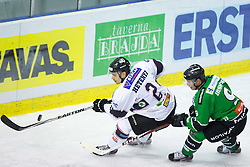 05.10.2014, Hala Tivoli, Ljubljana, SLO, EBEL, HDD Telemach Olimpija Ljubljana vs Fehervar AV19, 8. Runde, in picture Peter Hetenyi (Fehervar AV19, #2) vs Hunter Bishop (HDD Telemach Olimpija, #9) during the Erste Bank Icehockey League 8. Round between HDD Telemach Olimpija Ljubljana and Fehervar AV19 at the Hala Tivoli, Ljubljana, Slovenia on 2014/10/05. Photo by Matic Klansek Velej / Sportida
