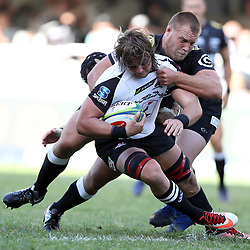 DURBAN, SOUTH AFRICA - MARCH 10: Ross Geldenhuys of the Cell C Sharks tackling Wimpie van der Walt of the HITO-Communications Sunwolves during the Super Rugby match between Cell C Sharks and Sunwolves at Jonsson Kings Park Stadium on March 10, 2018 in Durban, South Africa. (Photo by Steve Haag/Gallo Images)