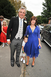 VISCOUNT & VISCOUNTESS ASTOR and their grandson at the wedding of Lohralee Stutz and the Hon.William Astor at St.Augustine's Church, East Hendred, Oxfordshire on 5th September 2009.