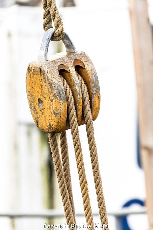 wooden ship waist with rope photographed up close