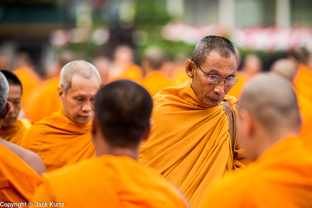 08 SEPTEMBER 2013 - BANGKOK, THAILAND:  Buddhist monks during a mass alms giving ceremony in Bangkok Sunday. 10,000 Buddhist monks participated in a mass alms giving ceremony on Rajadamri Road in front of Central World shopping mall in Bangkok. The alms giving was to benefit disaster victims in Thailand and assist Buddhist temples in the insurgency wracked southern provinces of Thailand.     PHOTO BY JACK KURTZ
