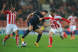Southampton's Graziano Pelle is challenged by Stoke's Erik Pieters and Stoke's Geoff Cameron - Photo mandatory by-line: Dougie Allward/JMP - Mobile: 07966 386802 - 29/10/2014 - SPORT - Football - Stoke - Britannia Stadium - Stoke City v Southampton - Capital One Cup - Fourth Round