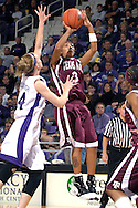 Texas A&M guard Takia Starks (3) scores two of her team high 10 points in the first half over Kansas State forward Carolyn MaCullough (44) Bramlage Coliseum in Manhattan, Kansas, January 6, 2007.  K-State upset 17th ranked Texas A&M 48-45.