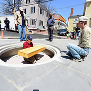 """Taken on May 6, 2015, at the African Burying Ground Memorial in Portsmouth NH, during a """"dry run"""" of fitting the new coffins into the crypt a few weeks before the memorial's official opening."""