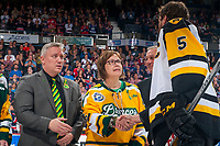 REGINA, SK - MAY 25: Humboldt Broncos president Kevin Garinger and Carol Borns, the mother of the late Dayna Borns, athletic therapist of the Humboldt Broncos shake the hand of Justin Lemcke #5 of Hamilton Bulldogs at the Brandt Centre on May 25, 2018 in Regina, Canada. (Photo by Marissa Baecker/CHL Images)