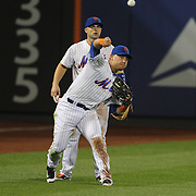 New York Mets fielders David Wright, Wilmer Flores and Michael Conforto, fail to make a catch from a fly ball by  A.J. Pierzynski,, Atlanta Braves, but the situaton was redeemed when Michael Conforto threw him out at second base during the New York Mets Vs Atlanta Braves MLB regular season baseball game at Citi Field, Queens, New York. USA. 22nd September 2015. Photo Tim Clayton
