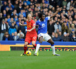 Everton's Romelu Lukaku challenges Liverpool's Martin Skrtel - Photo mandatory by-line: Dougie Allward/JMP - Tel: Mobile: 07966 386802 23/11/2013 - SPORT - Football - Liverpool - Merseyside derby - Goodison Park - Everton v Liverpool - Barclays Premier League